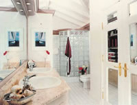 Sea Breeze: Master bath with marble and glass